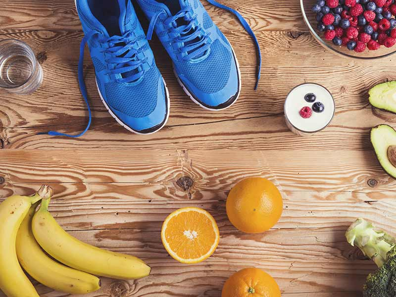 running shoes, fruit, vegetables and a smoothie